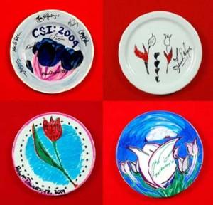 Celebrity signed and designed plates.
