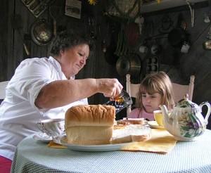 Darlene prepares bread and molasses for her granddaughter.